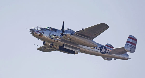 """North American B-25 Mitchell """"Panchito"""" in a fly-by — photo by Joe May"""