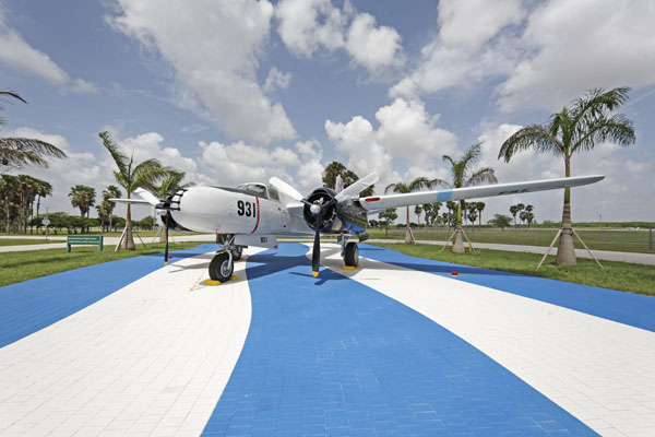 Douglas B-26 sitting atop the stripes of the Cuban flag at the Bay of Pigs Memorial -- photo by Joe May