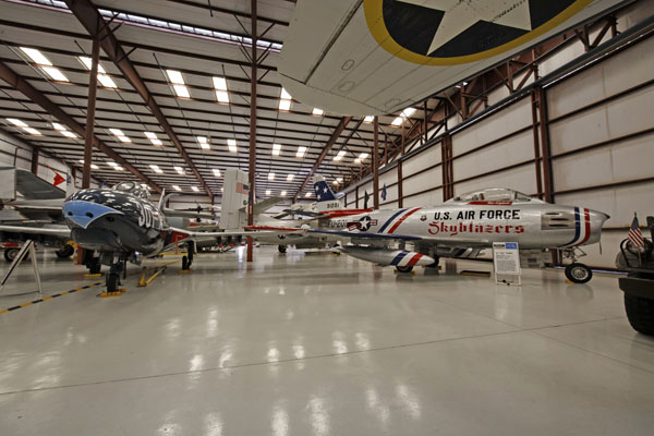"VAC hanger view showing the North American F-86 Sabre ""Skyblazers"" — photo by Joe May"