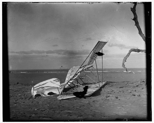 Wrecker Wright glider at Kitty Hawk on 10 October 1900 — Library of Congress photo  taken by the Wright Brothers