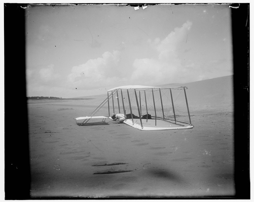 Wilbur Wright after just landing a Wright glider design at Kitty HAwk in 1901 — Library of Congress photo  taken by the Wright Brothers