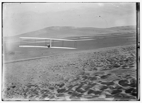 24 October 1902, Wilbur Wright piloting a Wright glider into a right hand turn at Kitty Hawk — Library of Congress photo  taken by the Wright Brothers