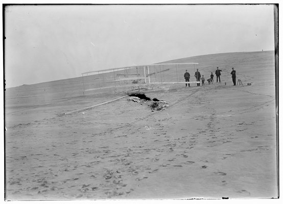blog 00612v 1903 machine on the launching track at Big Kill Devil Hill prior to the December 14th trial lifeguard unit in back Wrights photo