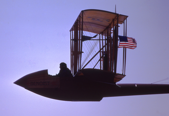 Pilot Ed Hoffman Sr. in flight with the replica Benoist XIV Air Boat on the 75th anniversary of the first regularly scheduled airline flight on 1 January 1984 — photo by Joseph May