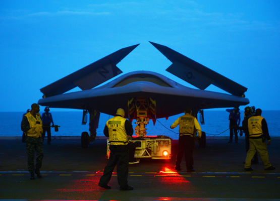 Northrop Grumman X-47B aboard the USS George H.W. Bush (CVN-77). The scene will soon be comman palce as U.S. Navy carriers groups will send these unmanned aerial vehicles (UAV) on autonomaous missions  Mass Comm Spec 2nd Class Timothy Walter