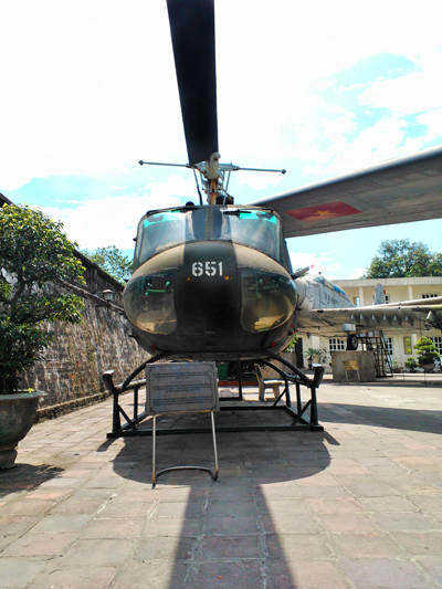 "UH-1 Iroquois ""Huey"" in the courtyard of the Vietnam Military History Museum in Hanoi, a view familiar to many an infantryman — photo by Catherine Dowman ©2013"