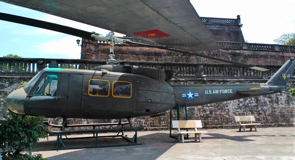 "UH-1 Iroquois ""Huey"" in the courtyard of the Vietnam Military History Museum in Hanoi (Hueys just don't look right with the cabin doors shut, do they?) — photo by Catherine Dowman ©2013"
