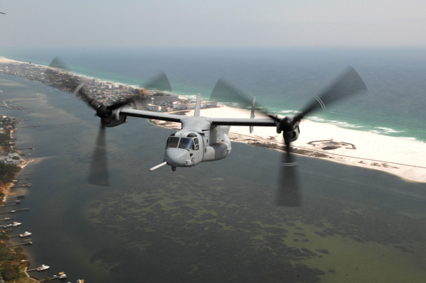 "MV-22 Osprey going ""feet dry"" over the Florida coast near Hurlburt Field — US Air Force photo by Senior Airman Andy M. Kin MV-22 Osprey going ""feet dry"" over the Florida coast near Hurlburt Field — US Air Force photo by Senior Airman Andy M. Kin"