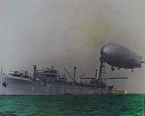 Colorized photograph showing the rigid airship Shenandoah ZR 1moored to the oiler Patoka AO 9 circa 1924 — U.S. Navy photo