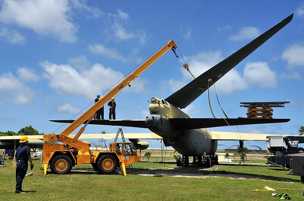 "Airmen of the 36th Maintenance Squadron unbolting the hinged vertical fin of ""Old-100"" Boeing B-52D Stratofortress at the Ar Light Memorial on Andersen AFB Guam — USAF photo by Staff Sgt. Melissa B. White"