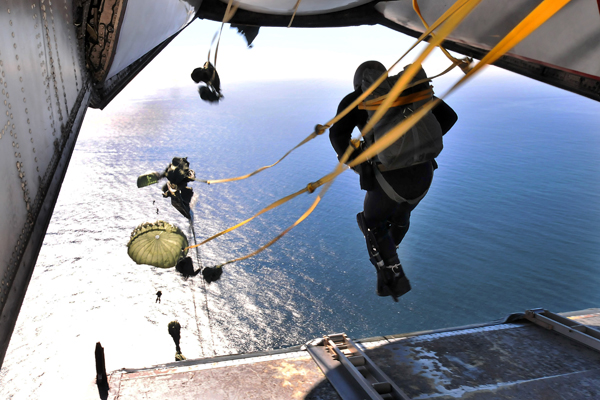 Personnel assigned to the Explosive Ordinance Disposal Unit 11 parachute from a C-2A Greyhound by static line — U.S. Navy photo by Mass Comm Spec 2nd Class David A. Brandenburg
