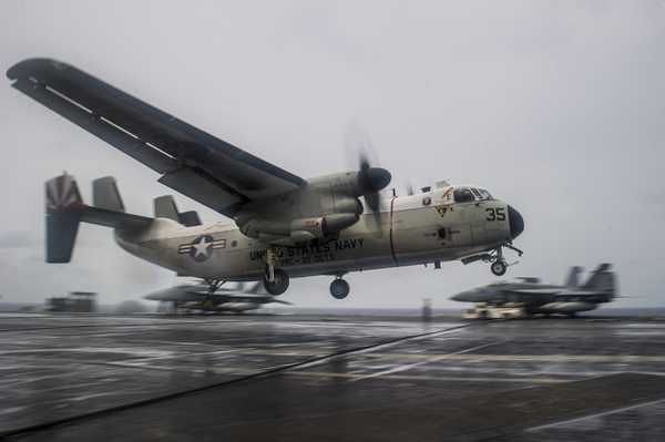 Grumman C-2A Greyhound trapping aboard CVN 73 USS George Washington during inclement weather — U.S. Navy photo by Mass Comm Spec 3rd Class Paolo Bayas