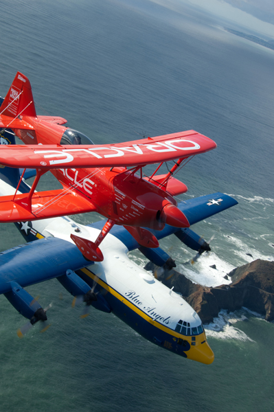 Fat Albert and Team Oracle's rare Oracle Challenger III  (Sean Tucker piloting) fly in close formation over San Franscisco Bay — U.S. Navy photo by Mass Comm Spec. 3rd Class Andrew Johnson