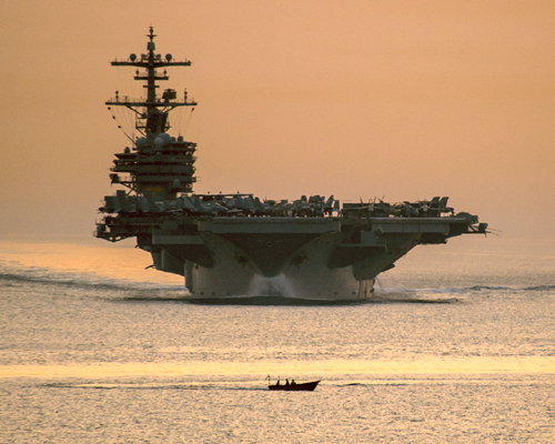 The USS George W. Bush (CVN 77) transiting the Straits of Hormuz  — U.S. Navy photo by Mass Comm Spec 3rd Class Abe McNatt
