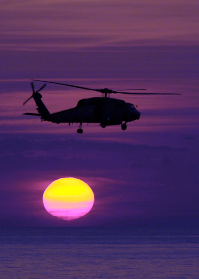 Sikorsky SH-60F Seahawk bathed in gorgeous light — U.S. Navy photo by Mass Comm Spec 2nd Class Nathan Laird