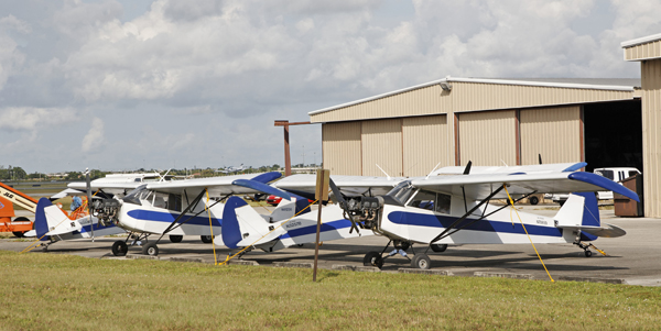 Four Piper J-3 Cubs (placed top-to-tail) vintage 1938 of Van Wagner Aerial Media at the North Perry Airport— photo by Joseph May