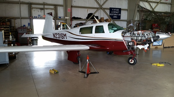 Servicing a Mooney M20K at WOMAM — photo by Joseph May