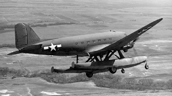 Douglas XC-47C with Edo Model 78 amphibious floats and gear down for an airfield landing—San Diego Air and Space Museum image archive
