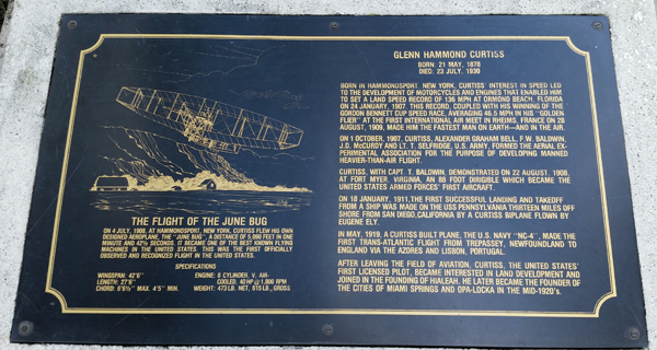 """Glenn Curtiss plaque and memorialization of his famous and precedent setting """"June Bug"""" flight (art work by Bruce Brady)—Joseph May/Travel for Aircraft"""