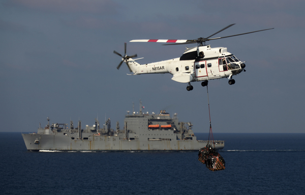 Somewhere in the Arabian Gulf recently a Eurocopter Puma on lease to USN from EP Aviation resupplies another vessel USMC image Staff Sgt Bobby J. Yarbrough