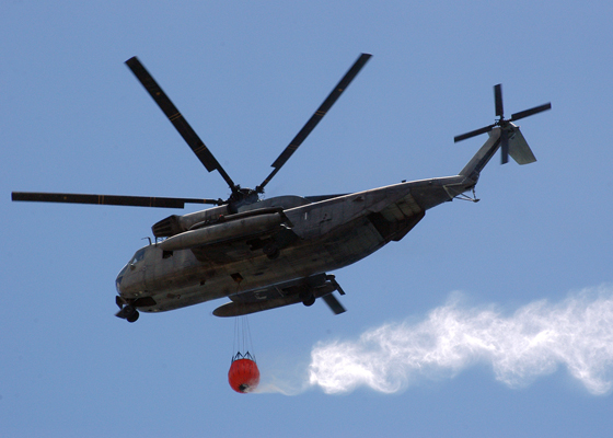 Sikorsky CH-53E Super Stallion with 2000 gallon water bucket--USN image journalist 3rd Class Ryan C. McGinley