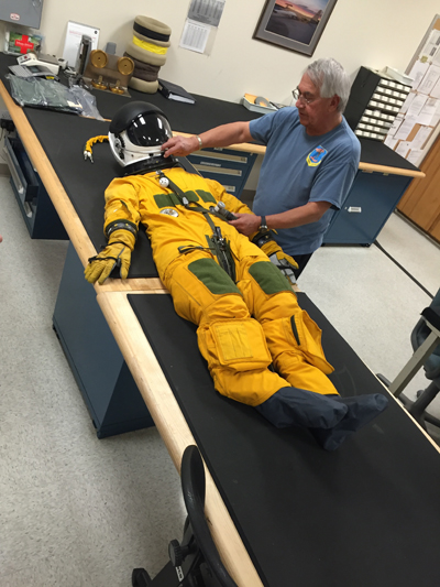 "Corky Cortes (Life Support Technician/NASA Armstrong Flight Research Center) checking a flight suit used on the ER-2 ""Dragonlady"" Nick Veronico image 2016"