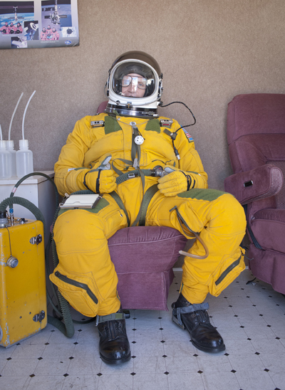 "Pilot in a flight suit in prep for a mission in an ER-2 ""Dragon Lady""—NASA image"