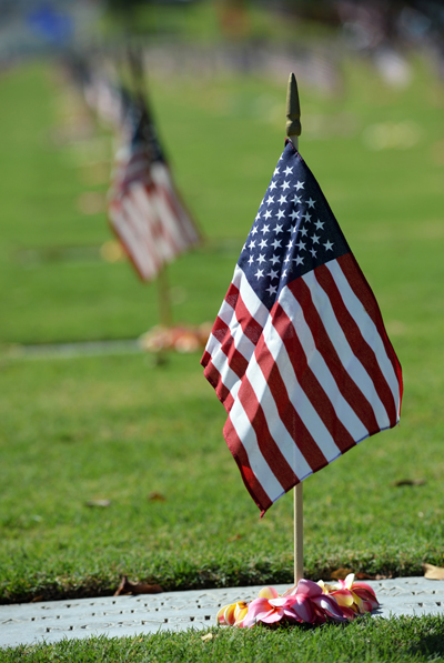 "Grave site flag at the National Memorial Cemetery of the Pacific, ""Punchbowl""--USN image Mass Comm Spec 2nd Class Laurie Dexter"