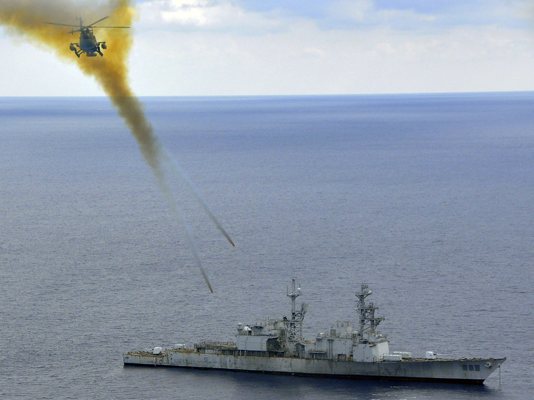 090429-N-0000X-001 ATLANTIC OCEAN (April 29, 2009) A Mexican BO-105 Bolkow helicopter fires 2.75 inch high-explosive rockets at the ex-USS Connolly (DD 979) during the sinking exercise portion of UNITAS Gold. This year marks the 50th iteration of UNITAS, a multinational exercise that provides opportunities for participating nations to increase their collective ability counter illicit maritime activities that threaten regional stability. Participating countries are Brazil, Canada, Chile, Colombia, Ecuador, Germany, Mexico, Peru, U.S. and Uruguay. (U.S. Coast Guard photo by Petty Officer Seth Johnson/Released)