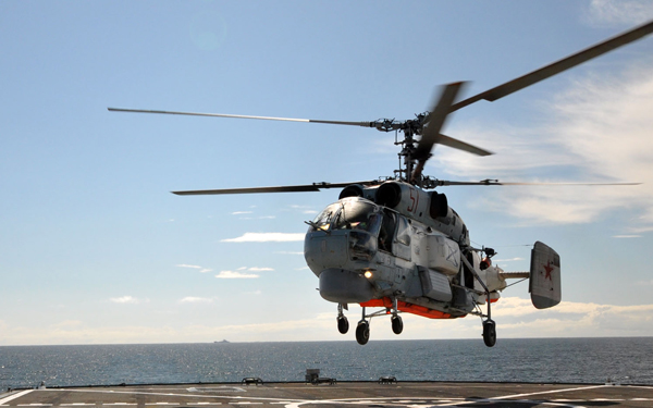100722-N-1098L-030 English Channel (July 22, 2010) Military Sealift Fleet Support Command (MSC) civil service mariner Boatswain's Mate Anthony Brooks, a landing signal enlisted flight crewmen, directs a Kamov (KA 26) Helix Soviet navy helicopter for takeoff aboard the amphibious command ship USS Mount Whitney (LCC/JCC 20) as part of an international partnership training during FRUKUS 2010. FRUKUS is an annual naval exercise involving the maritime forces of France, Russia, the United Kingdom and the United States, developed to formulate joint activities within a multi-national operational formation while improving interoperability between the nations. (U.S. Navy photo by Chief Warrant Officer Jeffrey Lund/Released)