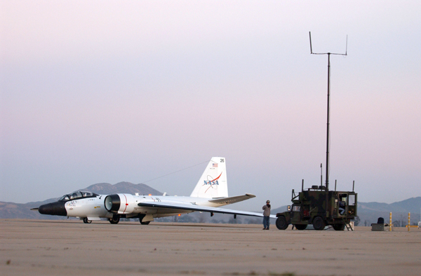 060224-F-0017M-005 San Diego (Feb. 24, 2006) - A NASA WB-57 loaded with a Battlefield Airborne Communications Node (BACN) communicates with the U.S. Joint Forces Command's Rapid Attack Information Dissemination-Execution Relay mobile vehicle (RAIDER) on board U.S. Marine Corps Air Station Miramar. BACN's forward-edge tactical server provides real-time information access to situation awareness, surveillance, imagery and network-management information for air and ground-based units, including the RAIDER. Northrop Grumman in partnership with NASA's Johnson Space Center is preparing BACN for test evaluation during a joint expeditionary force experiment in April. U.S. Air Force photo by Senior Airman Michele Misiano (RELEASED)