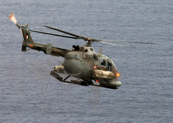 090429-N-2821G-139 ATLANTIC OCEAN (April 29, 2009) A Mexican BO-105 Bolkow helicopter fires 2.75 inch high-explosive rockets at the ex-USS Connolly (DD 979) during the sinking exercise portion of UNITAS Gold. This year marks the 50th iteration of UNITAS, a multinational exercise that provides opportunities for participating nations to increase their collective ability counter illicit maritime activities that threaten regional stability. Participating countries are Brazil, Canada, Chile, Colombia, Ecuador, Germany, Mexico, Peru, U.S. and Uruguay. (U.S. Navy photo by Mass Communication Specialist 2nd Class Alan Gragg/Released)