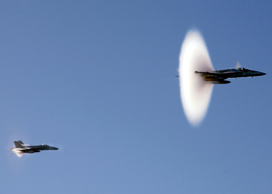 """040129-N-0905-024 Pacific Ocean (Jan. 29, 2004) – Lt. Col. William """"Chester"""" Waldron, Commanding Officer of the """"Black Knights"""" of Marine Fighter Attack Squadron Three One Four (VMFA-314) performs a super sonic fly-by for Columbia's Visual effects unit, while filming for the upcoming motion picture production """"Stealth."""" The Bremerton, Washington based nuclear powered aircraft carrier is currently underway for the first time since returning from an eight and half month western pacific deployment. Carl Vinson is conducting training with Carrier Air Wing Nine (CVW-9) and units of the Carl Vinson Carrier Strike Group (CSG). U.S. Navy photo by Photographer's Mate Airman Chris M. Valdez. (RELEASED)"""