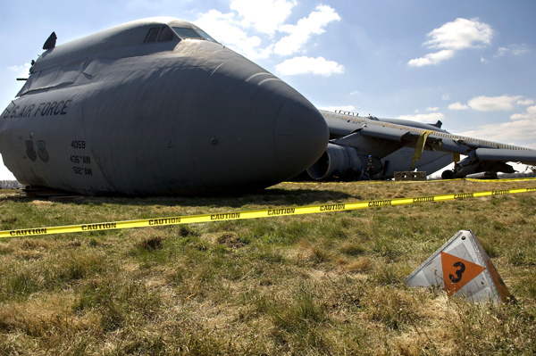 This C-5 Galaxy lies in a field on the south side of Dover Air Force Base, Del., after it crashed Monday, April 3, 2006. Specialists roped off the area with caution tape to preserve the scene until a safety investigation board completes its task. (U.S. Air Force photo/Doug Curran