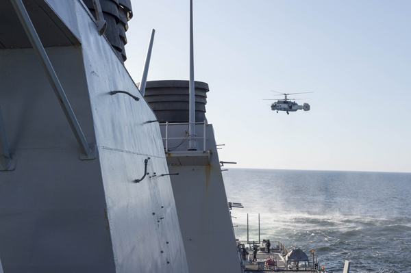 160412-N-ZZ999-003 BALTIC SEA (April 12, 2016) A Russian Kamov KA-27 HELIX helicopter flies low-level passes near the Arleigh Burke-class guided missile destroyer USS Donald Cook (DDG 75) while the ship was operating in international waters April 12, 2016. Donald Cook is forward deployed to Rota, Spain, and is conducting routine patrols in the U.S. 6th Fleet area of operations in support of U.S. national security interests in Europe. (U.S. Navy photo/Released)