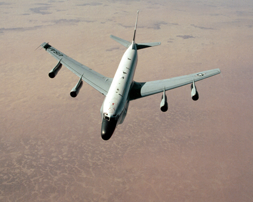 An RC-135 Stratoliner aircraft from the 9th Strategic Reconnaissance Wing approaches a KC-135 Stratotanker from the 1700th Air Refueling Squadron Provisional during Operation Desert Shield.
