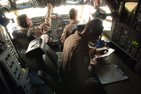 Captains Guy Perrow and Erik Dunkley and 1st Lt. Michael Morrison prep a RC-135 Rivet Joint for a flight. RC-135's have been deployed from the 55th Wing at Offutt Air Force Base, Neb., and maintained a constant presence in Southwest Asia for 6,000 days since Aug. 9, 1990, just prior to Operation Desert Shield. Captain Perrow is the aircraft commander, Captain Dunkley is the co-pilot, and Lieutenant Morrison is the navigator. (U.S. Air Force photo/Master Sgt. Scott Wagers)