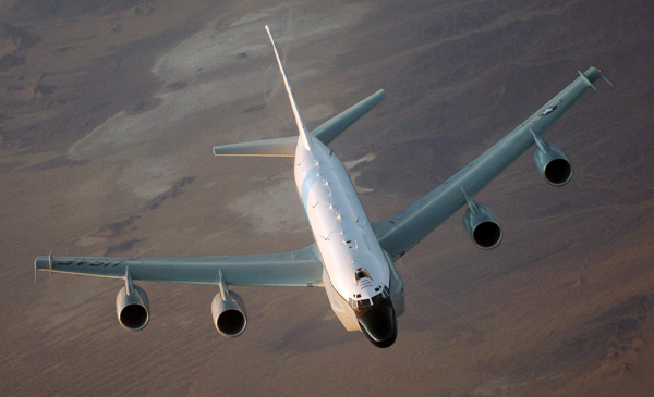 An RC-135 Rivet Joint flies over Afghanistan Jan. 9. The intelligence reconnaissance aircraft carries a 34-member crew has been consistently deployed to Southwest Asia for a milestone 6,000 days since Aug. 9, 1990, just before Operation Desert Shield. (U.S. Air Force photo/Master Sgt. Scott Wagers)