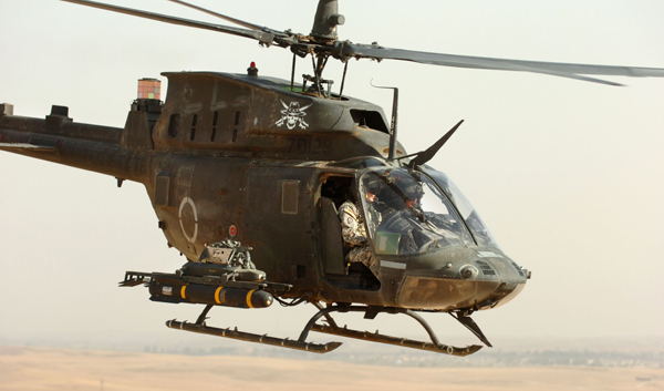 Armed with Hellfire missiles, Col. A.T Ball, the 25th Combat Aviation Brigade Commander flies a Kiowa (OH-58) during a recent mission in the area of Kirkuk, Iraq. The 25th CAB provides air support for ground forces throughout most of Iraq. Photo by Spc. Bryanna Poulin