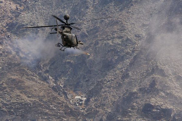 NANGARHAR PROVINCE, Afghanistan -- An OH-58D Kiowa Warrior from Task Force Saber, 82nd Combat Aviation Brigade, fires a 2.75-inch rocket at a mountainside during a test flight in eastern Afghanistan, Mar. 2, 2012. The Kiowa warrior is the Army's scout and reconnaissance aircraft, which often provides close support for ground troops on the battlefield. Saber's Kiowas lead the 82nd Combat Aviation Brigade, which has flown more than 65,000 hours across all airframes since October 2011. (U.S. Army photo by Sgt. 1st Class Eric Pahon, Task Force Poseidon Public Affairs)