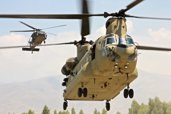 A CH-47 Chinook helicopter and UH-60 Black Hawk helicopter assigned to 101st Combat Aviation Brigade prepare to land at Tactical Base Gamberi during a visit from senior Afghan National Army and Resolute Support leaders July 30, 2015. (U.S. Army photo by Capt. Jarrod Morris, TAAC-E Public Affairs)