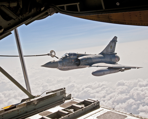 A U.S. Marine Corps KC-130J Super Hercules aircraft with Marine Aerial Refueler Transport Squadron (VMGR) 352 refuels a French air force Dassault Mirage 2000-5 aircraft during a refueling training mission over Djibouti Nov. 22, 2012. The mission was intended to improve interoperability between U.S. and French forces. (U.S. Air Force photo by Tech. Sgt. Joseph McKee/Released)