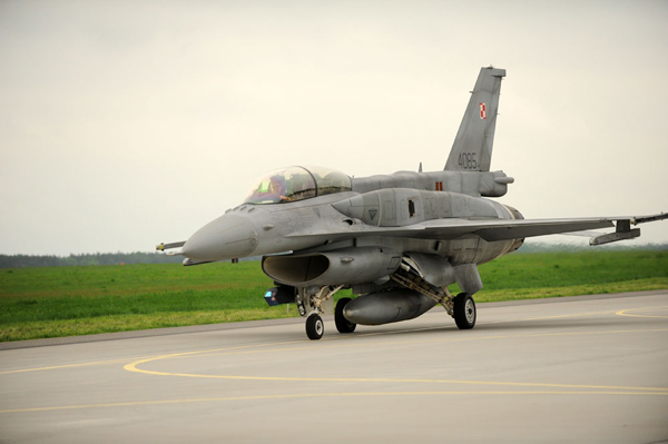A Polish air force F-16 Fighting Falcon aircraft taxis to the runway May 13, 2013, at Lask Air Base, Poland, to depart on a training mission with U.S. Air Force F-16s. Nearly 100 U.S. Airmen with the 115th Fighter Wing, Wisconsin Air National Guard traveled to the base for a two-week deployment in support of Poland Aviation Detachment, rotation 13-2. Detachment 1, 52nd Operations Group, the first permanent U.S. military presence in Poland, supported Poland's continued defense modernization and standardization with the U.S. and NATO. (DoD photo by Tech. Sgt. Kenya Shiloh, U.S. Air Force/Released)