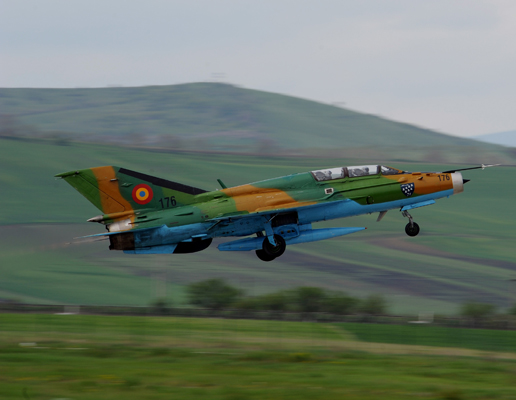 A Romanian Air Force MiG-21 Lancer aircraft takes off from Campia Turzii, Romania, April 17, 2014, during exercise Dacian Viper 2014. Dacian Viper is a bilateral air exercise designed to enhance interoperability and readiness between the U.S. Air Force and the Romanian Air Force. (DoD photo by Staff Sgt. R.J. Biermann, U.S. Air Force/Released)