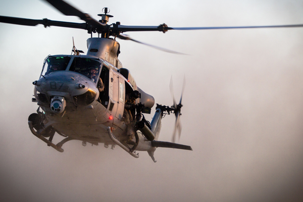 A U.S. Marine Corps UH-1Y Huey hovers over a landing zone before inserting Marines with 2nd Battalion, 7th Marines, 1st Marine Division during a heavy Huey raid at K-9 Village, Yuma Proving Grounds, Ariz., Oct. 7, 2015. The exercise is part of Weapons and Tactics Instructor (WTI) 1-16, a seven-week training event hosted by Marine Aviation Weapons and Tactics Squadron One (MAWTS-1) cadre. MAWTS-1 provides standardized tactical training and certification of unit instructor qualifications to support Marine Aviation Training and Readiness and assists in developing and employing aviation weapons and tactics. (U.S. Marine Corps photograph by Chief Warrant Officer 3 Jorge Dimmer, MAWTS-1 COMCAM/ Released)