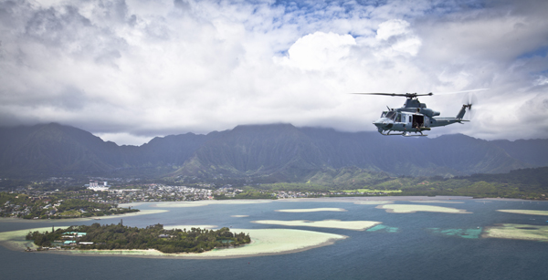 A UH-1Y Venom helicopter assigned to Marine Light Attack Helicopter Squadron (HMLA) 367 flies over Marine Corps Air Station Kaneohe Bay, Hawaii, during a Max Launch operation, May 6, 2014. Marine Aircraft (MAG) Group 24 conducted the flyby operation to improve interoperability between air and ground elements that included HMLA-367 and Marine Heavy Helicopter Squadron (HMH) 463 operating in the air while Marine Wing Support Detachment (MWSD) 24 and Marine Aviation Logistics Squadron (MALS) 24 maintained forward arming and refueling points on the ground. (DoD photo by Lance Cpl. Aaron S. Patterson, U.S. Marine Corps/Released)