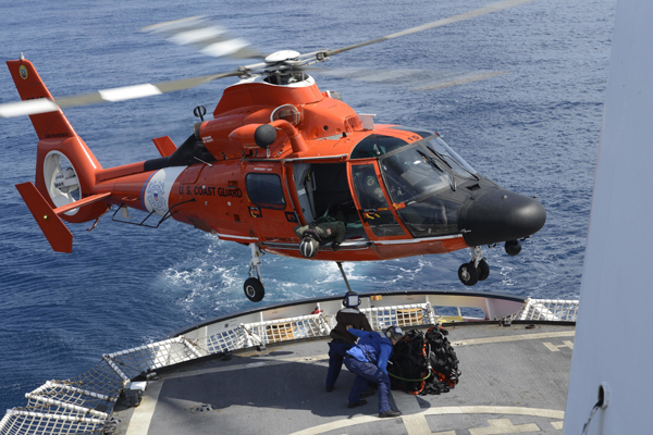 An MH-65 Dolphin helicopter conducts vertical replenishment training aboard the Coast Guard Cutter Active, March 12, 2015. The Active is on a counter narcotic deployment in the Pacific Ocean. (U.S. Coast Guard photo by Petty Officer 3rd Class Ryan Tippets)