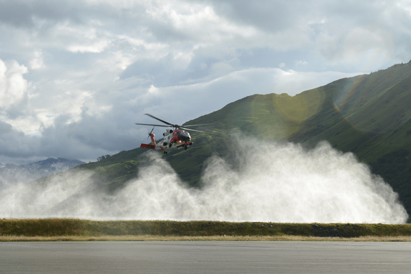 An MH-60 Jayhawk helicopter crew returns to Air Station Kodiak, Alaska, to transfer a patient to emergency medical personnel after hoisting him from a cruise ship July 22, 2015. The 83-year-old man was suffering from symptoms of a heart attack aboard a Holland America cruise ship requiring a medevac for immediate medical attention. (U.S. Coast Guard photo by Petty Officer 3rd Class Lauren Steenson)