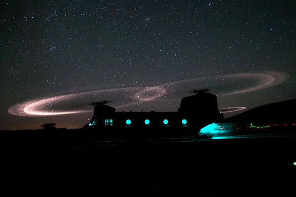Dust lights up the rotors of a CH-47 Chinook helicopter as paratroopers with 3rd Squadron, 73rd Cavalry Regiment load for an air assault mission near Combat Outpost Ab Band, May 23, 2012, Ghazni province, Afghanistan. The unit is part of the 82nd Airborne Division's 1st Brigade Combat Team, which deployed to the area in March to help bring security to the areas along the country's main road between Kabul and Kandahar.