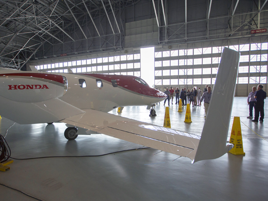 Employees are invited to view the HondaJet today, July 12 in the hangar in Building 1244*. The newly developed small jet, designed by a company better known for cars, motorcycles and lawn mowers, is one of a relatively new class of airplanes called light jets, designed to carry four to seven passengers and be fast, safe, reliable and able to use very small airports.